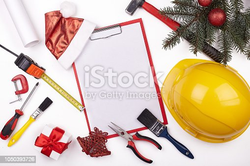 istock Construction hard hat and Christmas. 1050393726