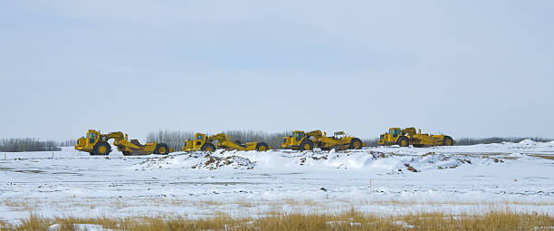 Construction Heavy Equipment parked in a Row Panorama stock photo