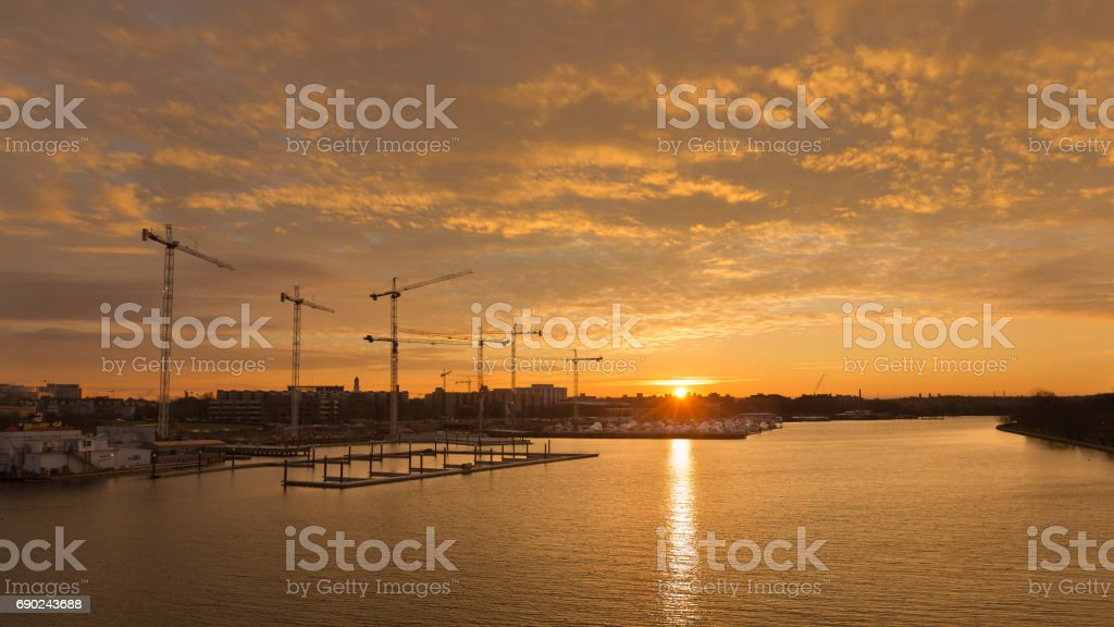 Construction in DC as cranes rise above the ground stock photo