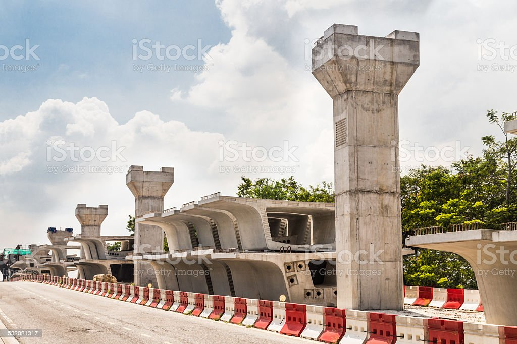 Construction of a mass transit train line in progress with heavy...