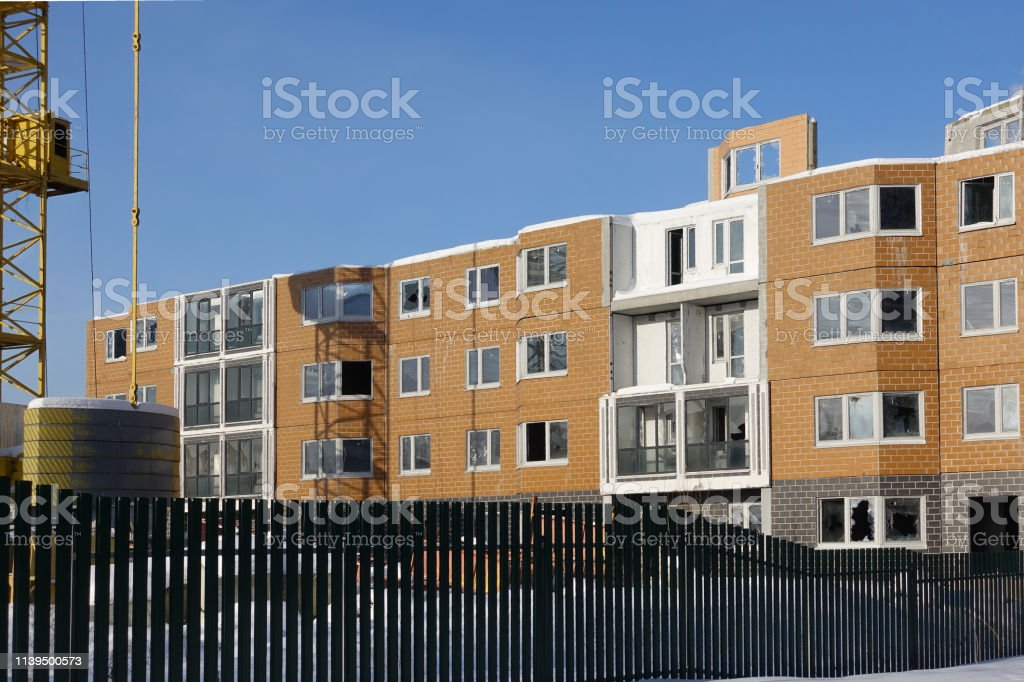 Construction in progress. Residential multi-storey building. House...