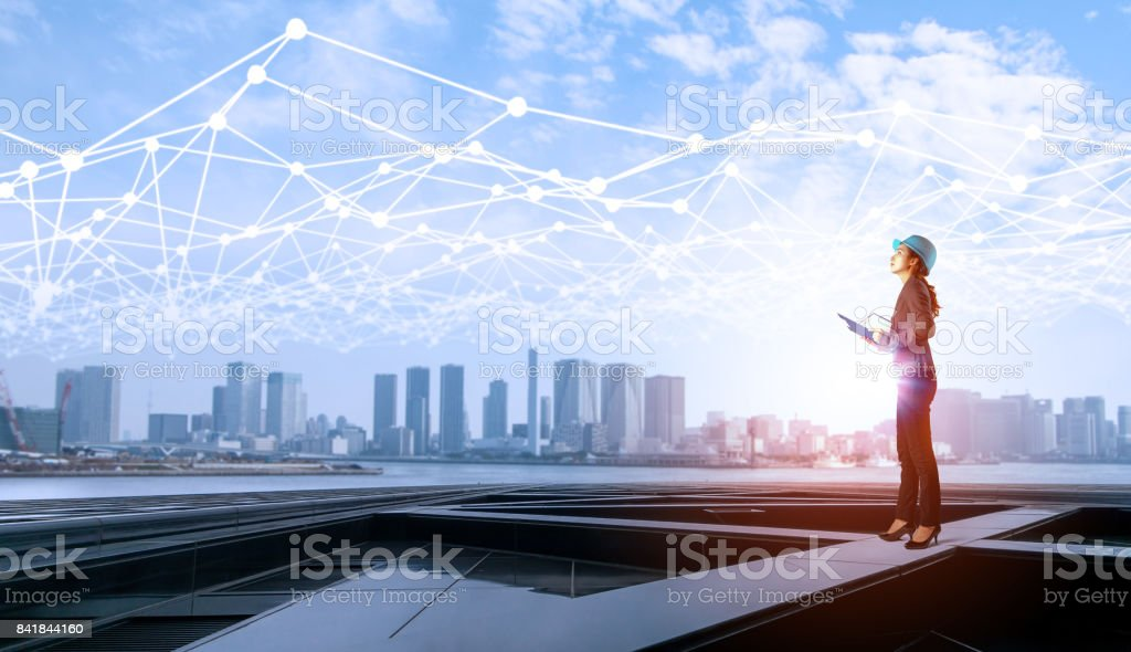 construction industry and Internet of Things concept. modern buildings. woman engineer. communication network. industry4.0 stock photo