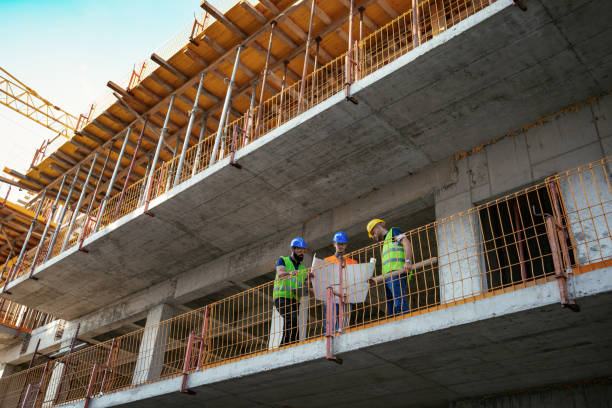Construction industry - architects and engineers discussing progress report stock photo