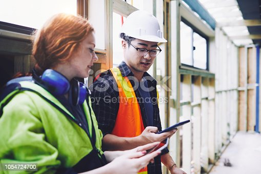 1054724700istockphoto Construction industry checking a phone app. 1054724700
