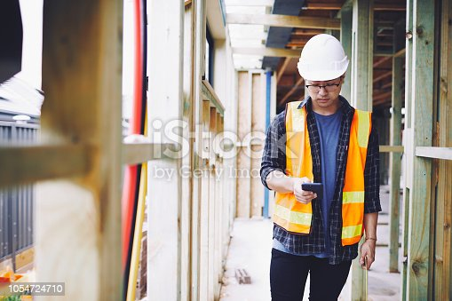 1054724700istockphoto Construction industry checking a phone app. 1054724710