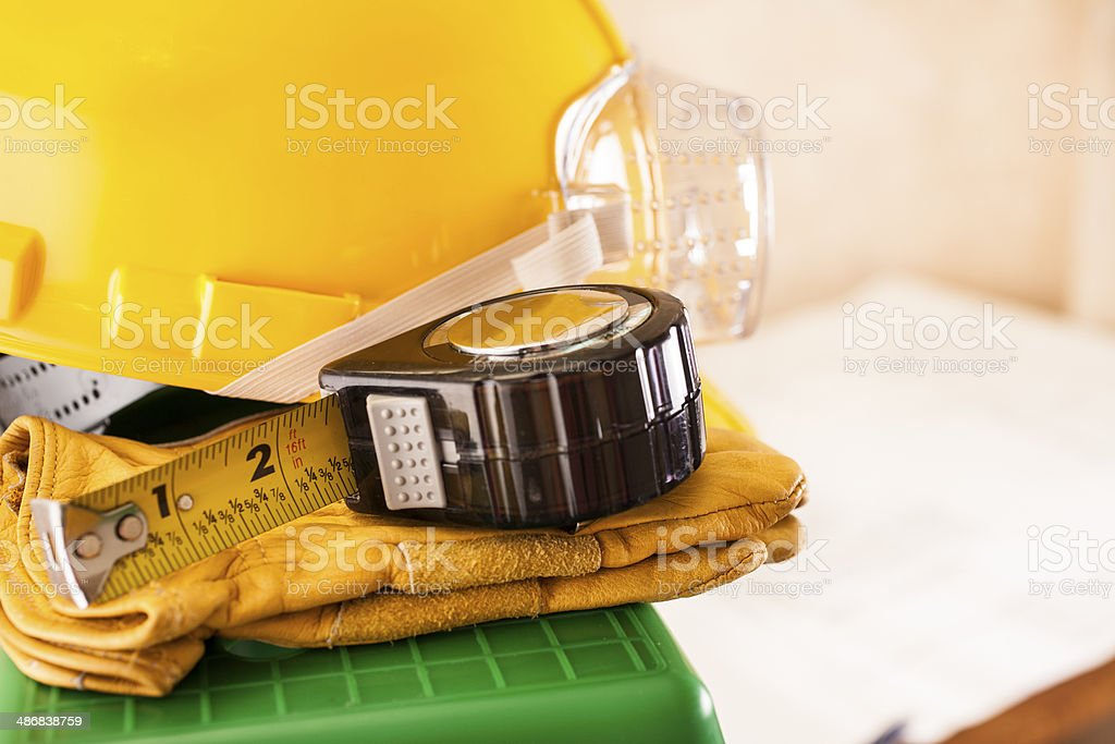 Construction Industry: Hardhat, goggles, gloves, tape measure. royalty-free stock photo