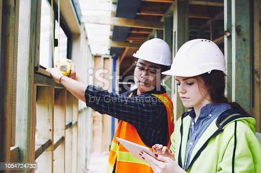 1054724700istockphoto Construction industry inspector checking a digital tablet app. 1054724732