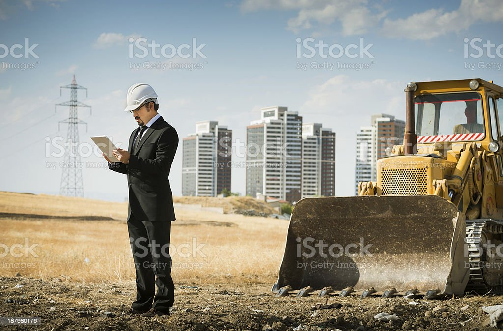 Construction inspection/architect using tablet computer stock photo