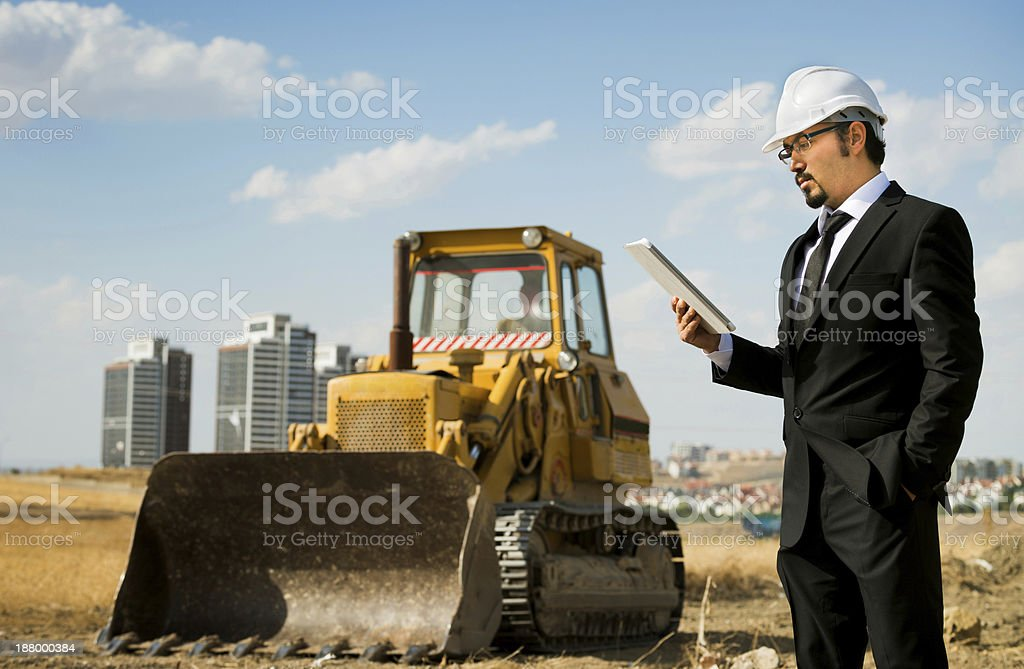 Construction inspection/architect using tablet computer royalty-free stock photo