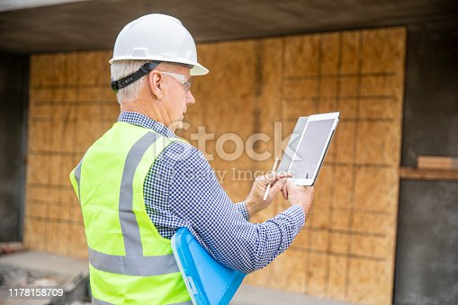 1041465228 istock photo Construction Inspector Photographing 1178158709