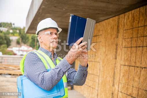 1041465228 istock photo Construction Inspector Photographing 1178162371