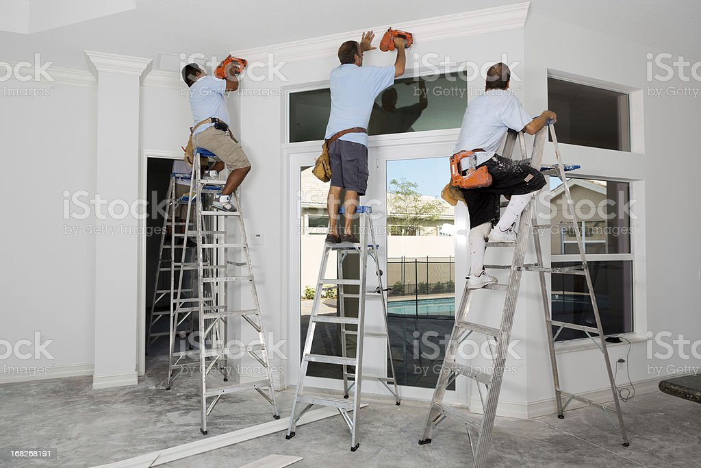 Construction: Installing crown molding royalty-free stock photo