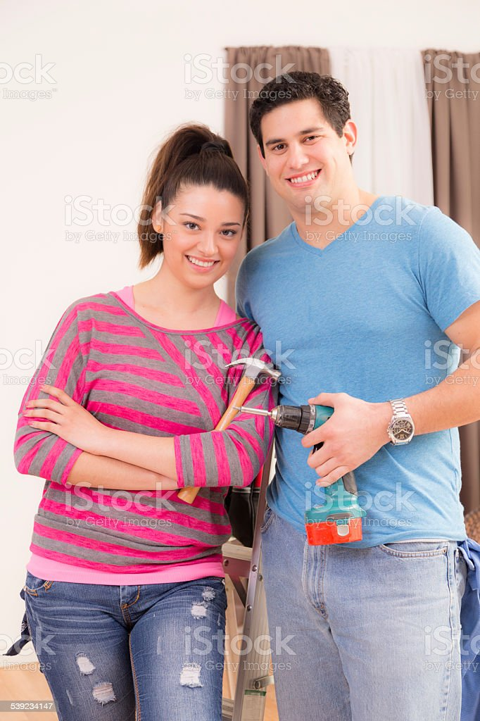 Construction: Latin couple work together on home improvement projects. royalty-free stock photo