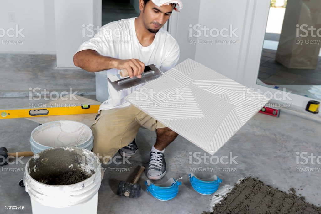 Construction: Laying a porcelain tile floor stock photo