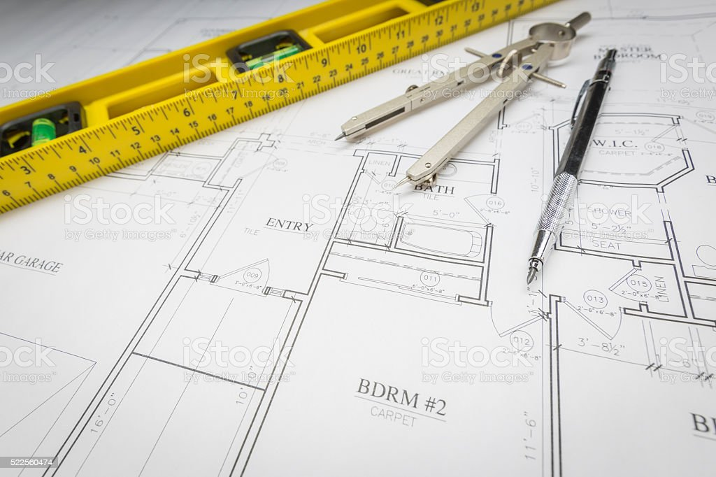 Construction Level, Pencil, Ruler and Compass Resting on House P stock photo