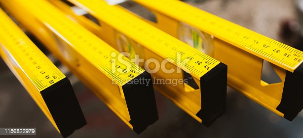Closeup of construction level rulers displayed in the tool store. Handyman measurement instrument.