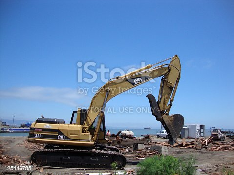 San Francisco - June 25, 2010: CAT Construction machine and People works at Pier in San Francisco.