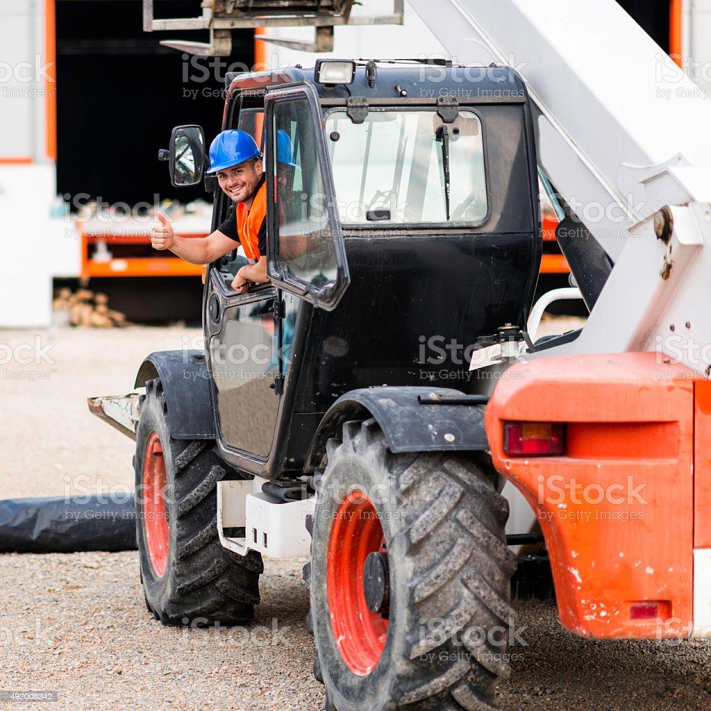 Construction machine operator stock photo