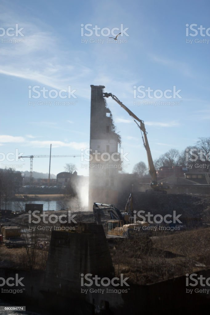 Construction machinery demolishing an old industy site stock photo