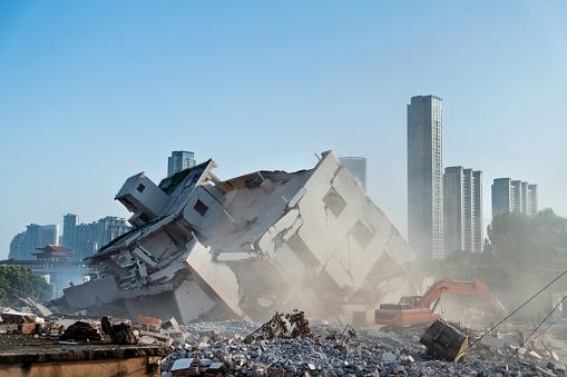 Construction machinery is demolishing the house.