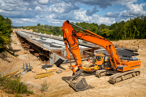 Construction machinery on construction of the viaduct on the new S7 highway, Poland
