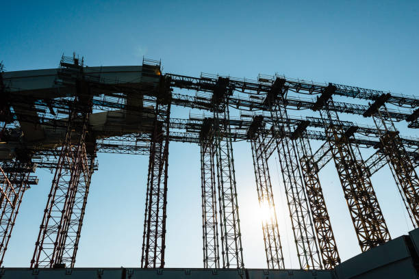 construction machinery on construction site - bridge built structure stock photos and pictures