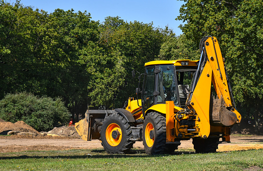 Construction machinery tractor with bucket and excavator