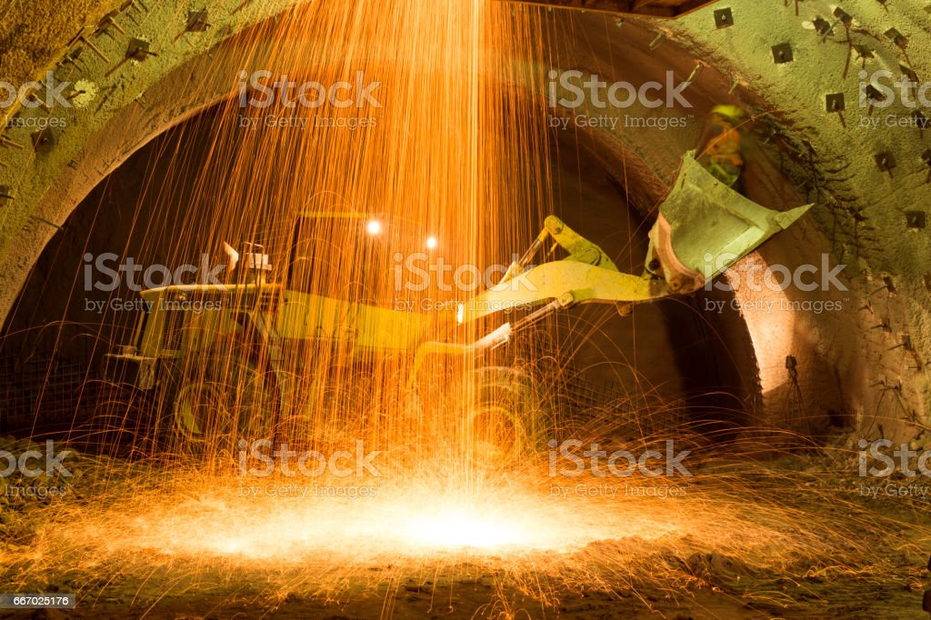 Construction Machinery Working in Tunnel Construction stock photo
