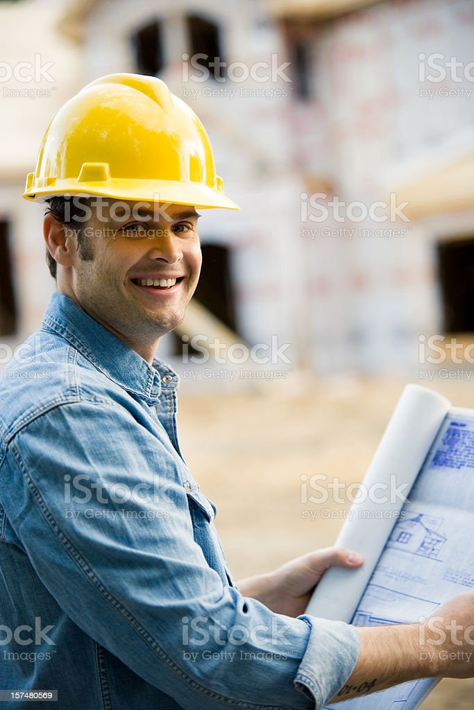 Construction Man Holding Blueprints Wearing Hard Hat royalty-free stock photo