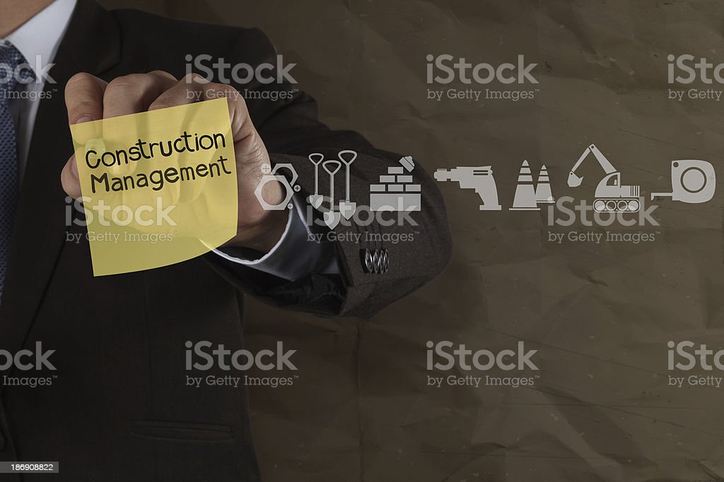 construction management on sticky note and icons with crumpled p royalty-free stock photo