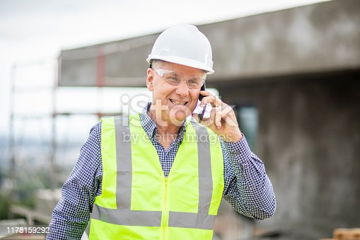 1054724700istockphoto Construction manager on phone 1178159292