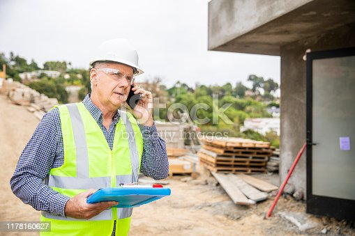 1054724700istockphoto Construction manager on phone 1178160627