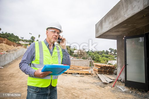 1054724700istockphoto Construction manager on phone 1178162534