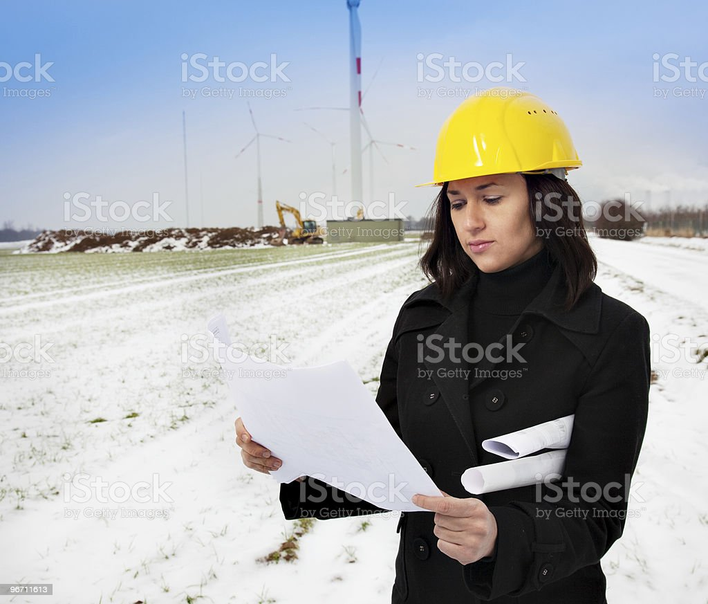 Construction manager reading plan royalty-free stock photo