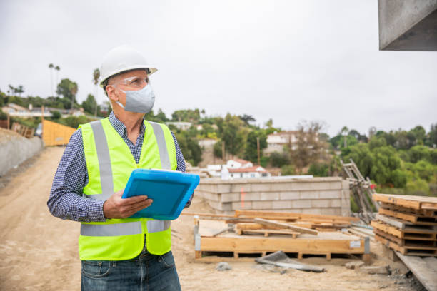Construction Manager Wearing a Mask Inspection stock photo