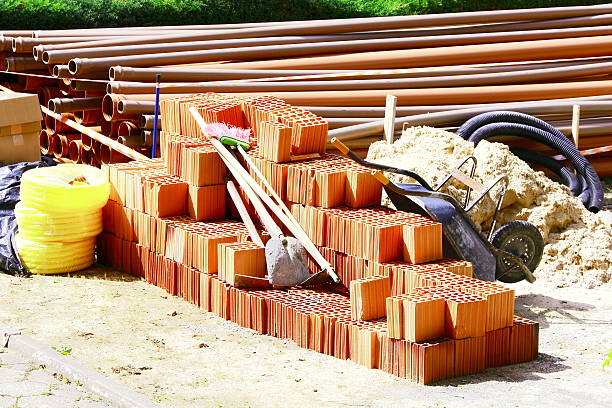 Construction Material. Large group of building material on the ground      mattock stock pictures, royalty-free photos & images