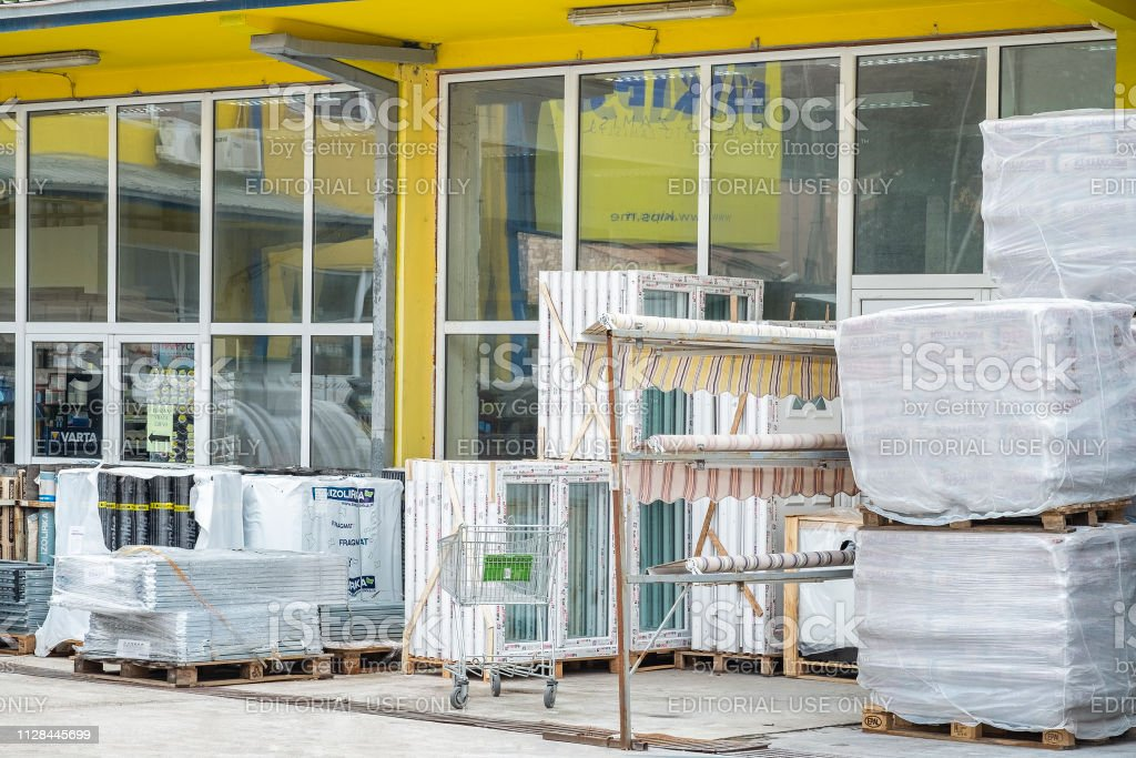 Construction materials are exhibited for sale in the yard of a...