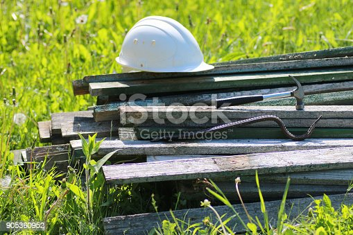 istock Construction materials on the grass 905360952