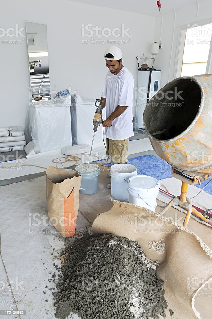 Construction: Mixing Glue to lay a porcelain tile floor stock photo