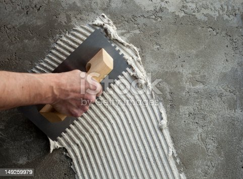istock construction notched trowel with white cement 149259979