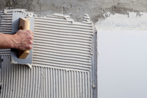 construction notched trowel with white cement