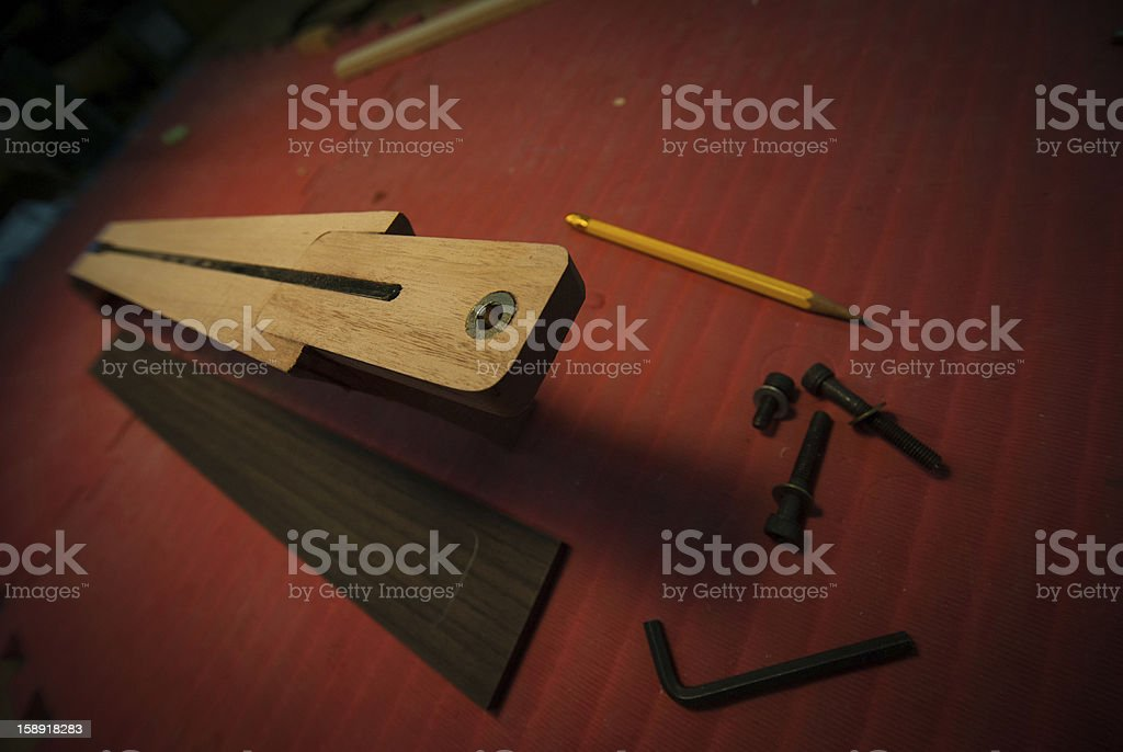 Construction of a guitar neck royalty-free stock photo
