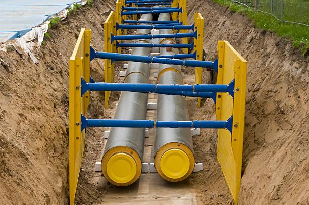Bau eines Einsteigloch für district Heizung pipes – Foto