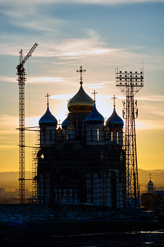 Construction of a new church in Yuzhno-Sakhalinsk city, Russia, back lit