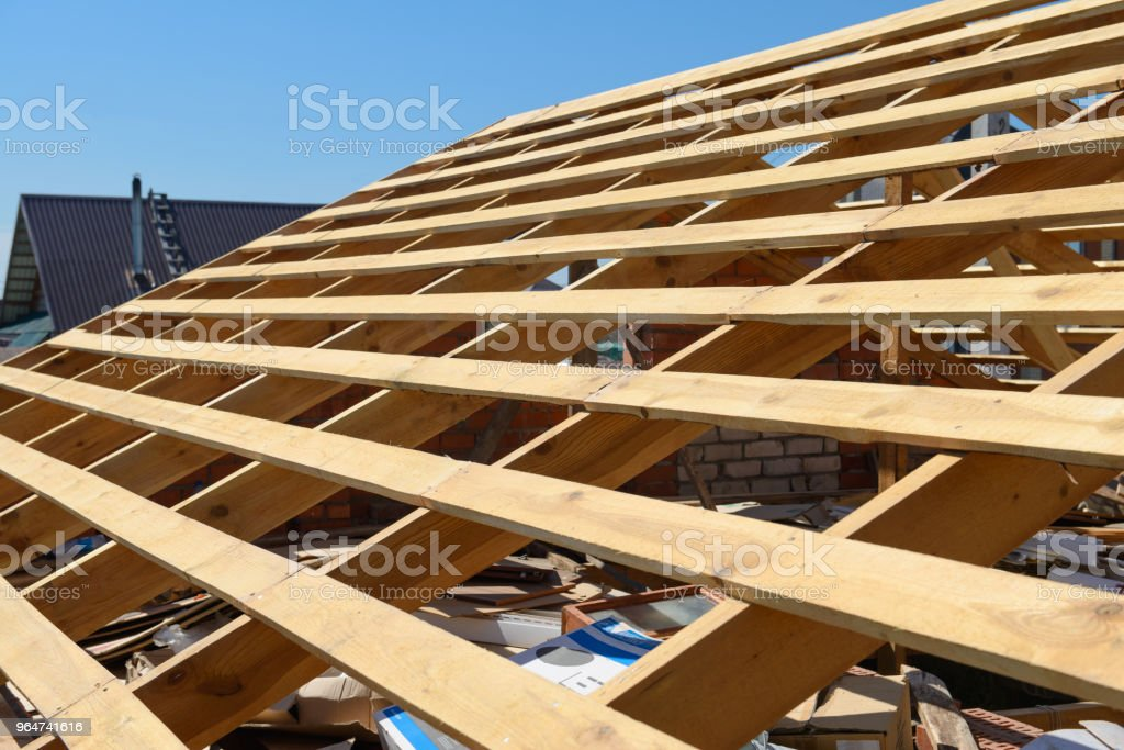 construction of a new frame of the roof of the house royalty-free stock photo