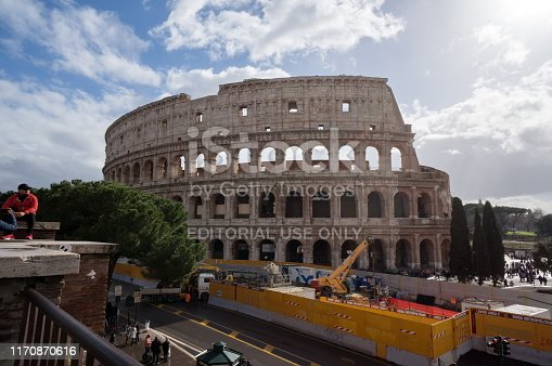 Rome / Italy - January 28, 2019: Construction of a new metro station near the amphitheater Colosseum (construction years 72-80), an architectural monument of Ancient Rome.
