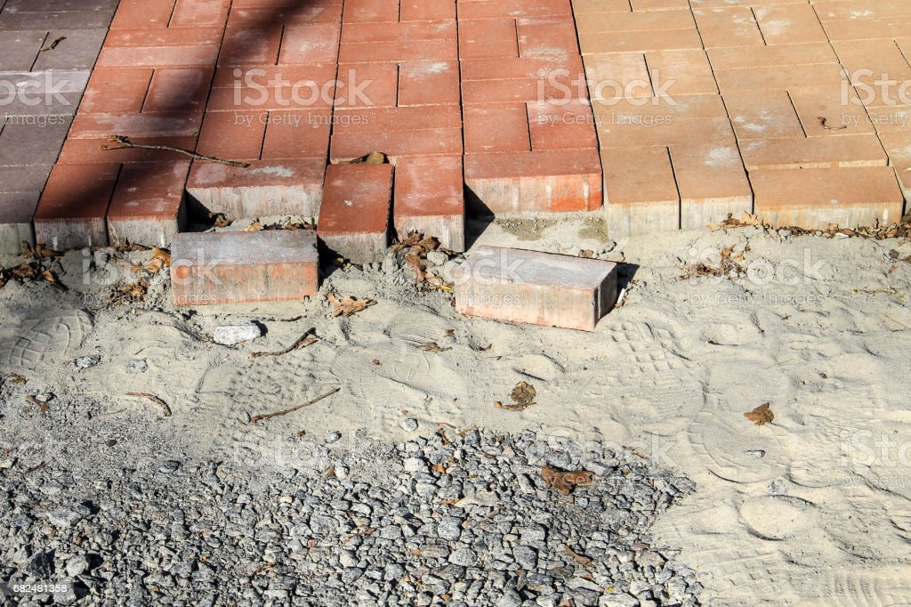 Construction of a new pavement of paving slabs. Pavement cobblestone blocks construction of path, road or sidewalk royalty-free stock photo