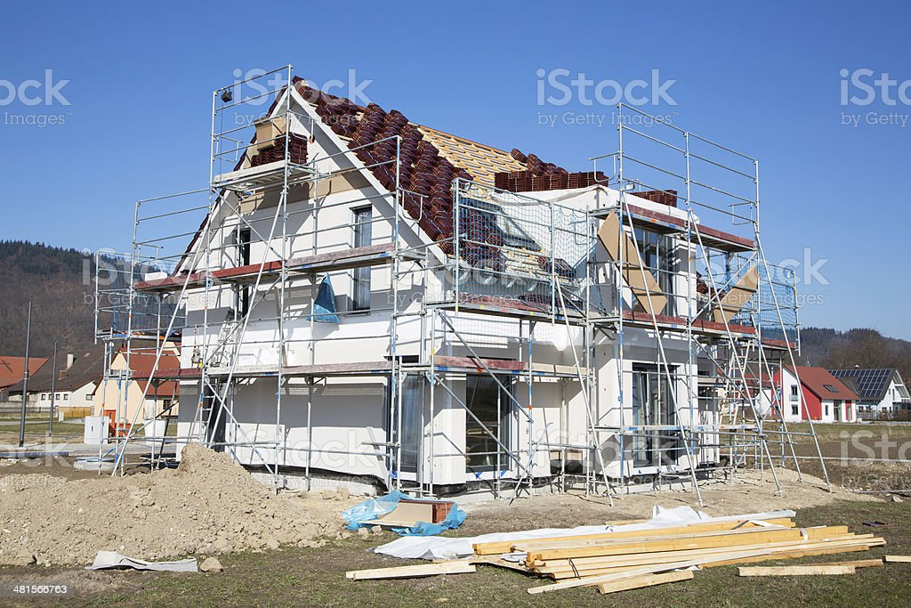 Construction of a new prefabricated house of stone and wood. stock photo