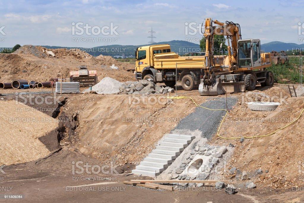 Construction of a rainwater retention basin for a housing development stock photo