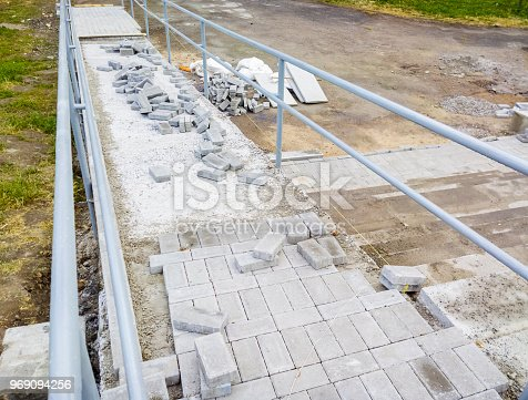 666724598 istock photo Construction of a ramp for disabled people and cyclists. Selective focus. 969094256